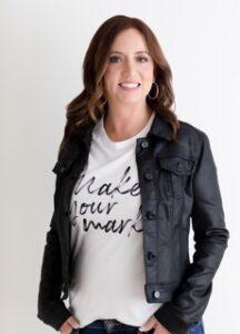 """Author Shaylene King, headshot, brunette with big smile, black jacket, white t-shirt """"Make Your Mark"""""""
